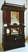 Welte Style 2 Cottage Orchestrion in an ebonized Italian Renaissance case.