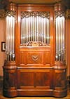 Welte 100 key Philharmonic Organ in a mahogany case with tin display pipes.