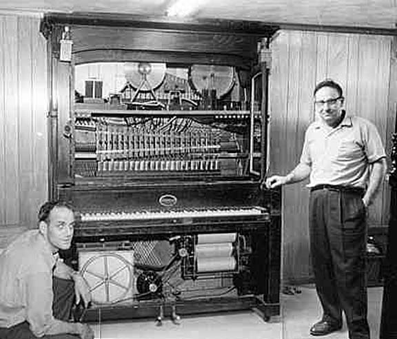 Neal White and Roy Haning in 1960 alongside their Coinola Style CO orchestrion.